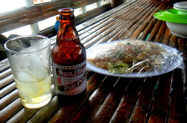 A bottle of San Miguel Pale Pilsen at Raymen Beach in Guimaras