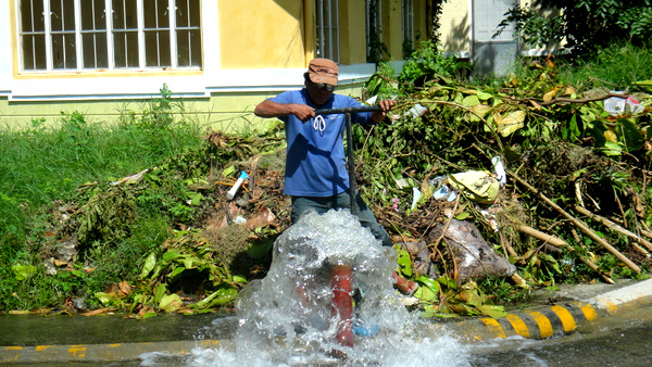 MIWD employee flushing out our water in our Iloilo subdivision