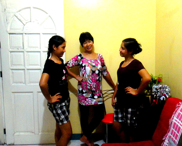 Michelle, My Asawa, and April posing for the camera