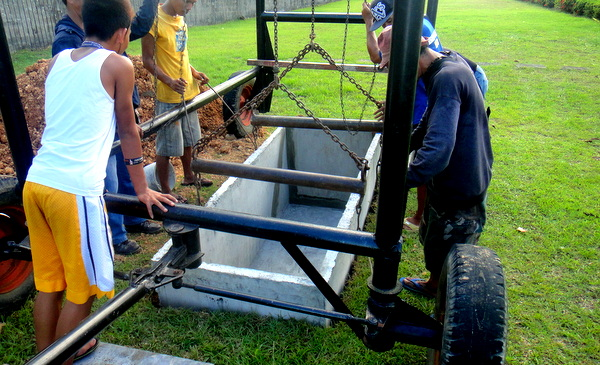 The vault is lowered at Guimaras Gardens Memorial Park