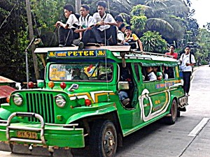 jeepney in Guimaras loaded up with school kids on top