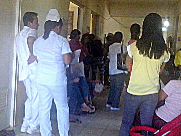 a crowd waits at the outpatient dept at guimaras provincial hospital