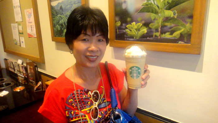 my asawa enjoying a coffee at starbucks at the district northpoint