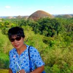 my wife poses by chocolate hills bohol