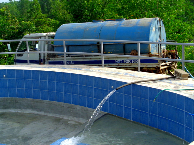 water truck fills our new pool in the philippines
