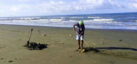 Baybay Beach Sweepers Bury Garbage in Sand