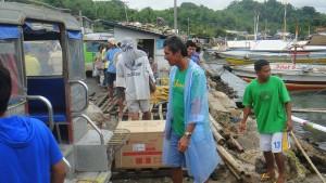 Pump Boat Owner Larry Inspecting our Loaded Jeepney on Jordan Wharf in Guimaras