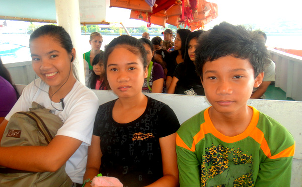 Michelle, Shaina and Sharwin on the pump boat to the Jordan Wharf in Guimaras