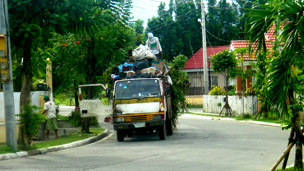 Garbage pick-up in Savannah Subdivision in Iloilo