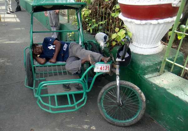 Sleeping pedicab driver in Iloilo