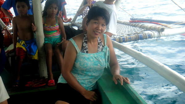 My lovely asawa on the pump boat going island hopping