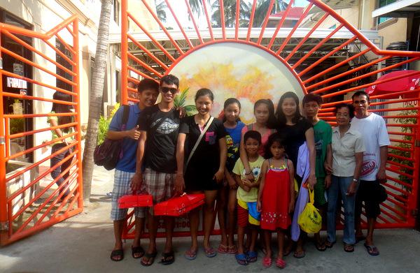 The crew at Raymen Beach Resort entrance