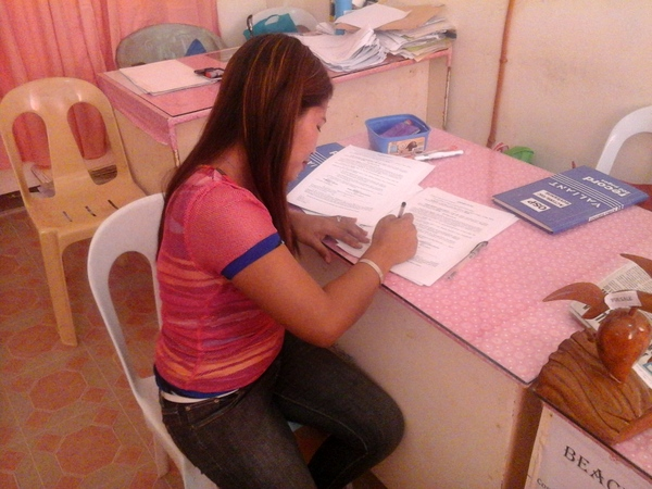 Ester signing the paperwork