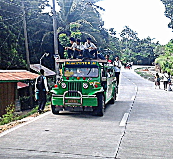 loaded jeepney picking up more passengers in Guimaras