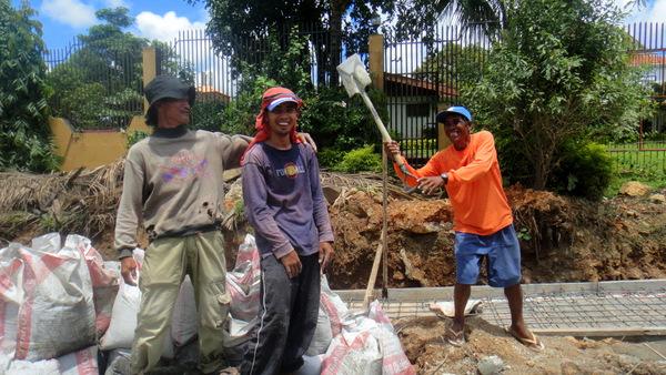 construction crew in guimaras mugs for the camera