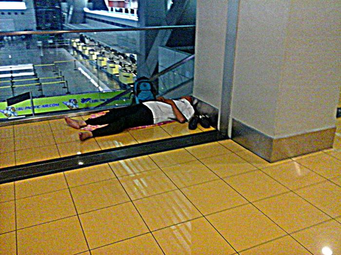 taking a nap at terminal 3 NAIA