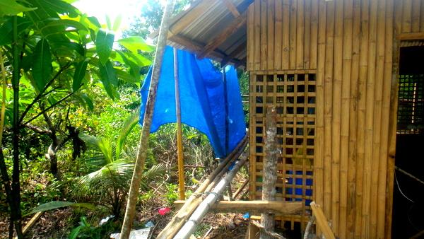 outside bamboo scaffolding for nipa hut construction