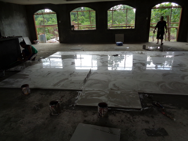 floor tile is being laid in our sala