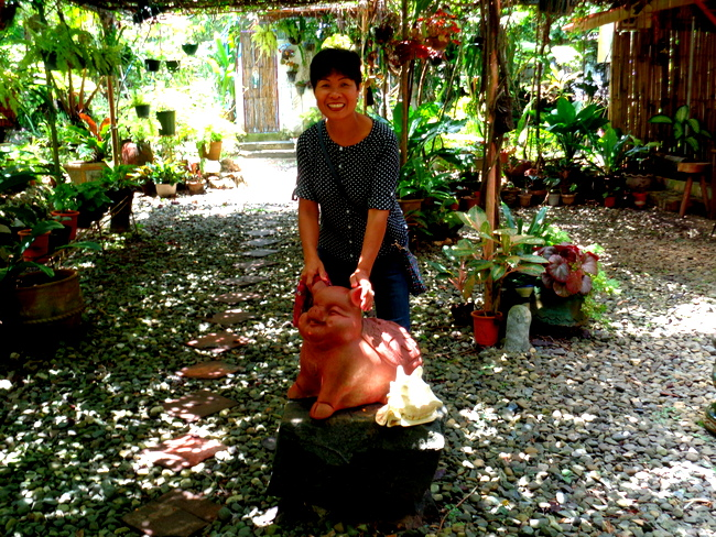 my spouse poses with the pig at neptune pittmans's