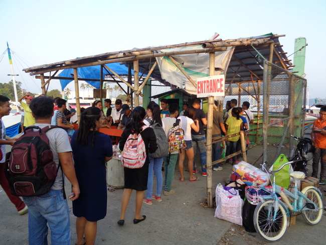 passengers waiting for pump boat ticket parola dock iloilo