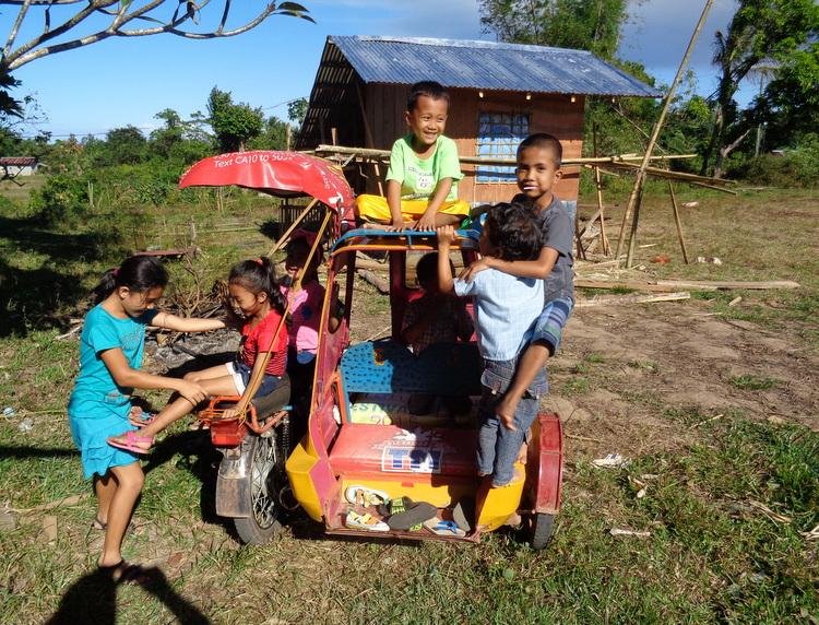 kids on trike in philippines