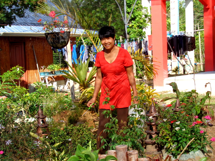 The Sainted Patient Wife at work in her new garden in Guimaras