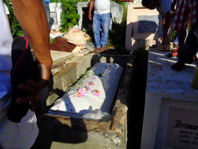 flowers are tossed on melchor's coffin