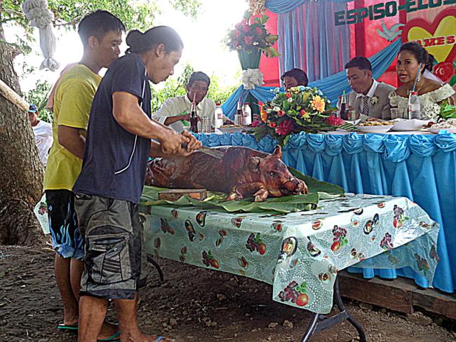 lechon is a standard at any filipino celebration