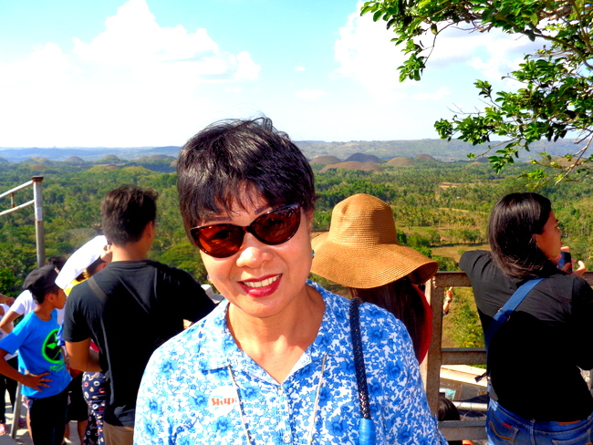 my spouse and tourists by chocolate hills bohol