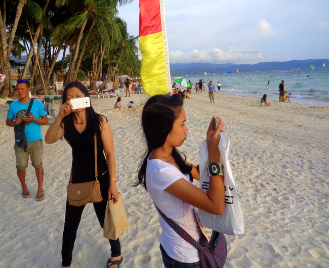 marjorie and shaina taking pics at boracay