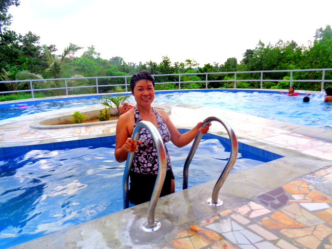 my lovely filipina wife exits our new swimmin pool in the philippines