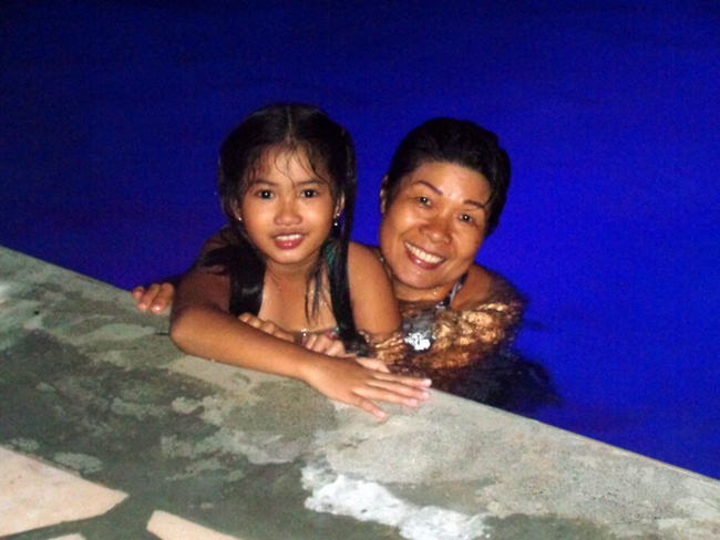 our niece and her auntie in our new swimming pool in the philippines